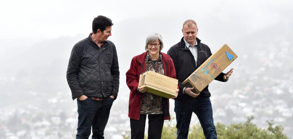 Predator Free Dunedin project manager Rhys Millar (left), Conservation Minister Eugenie Sage and Predator Free 2050 science strategy project manager Dan Thompkins place traps at Prospect Park in North Dunedin yesterday. Photo: Peter McIntosh