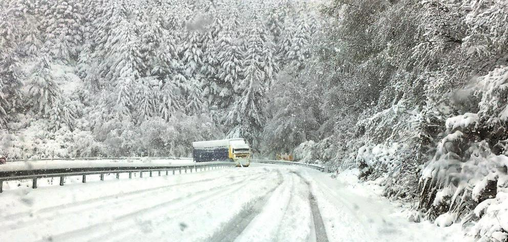 A truck edges towards Te Anau yesterday afternoon on snow-blanketed Blackmount-Redcliff Rd, near Monowai in western Southland. Photo: Southland District Council