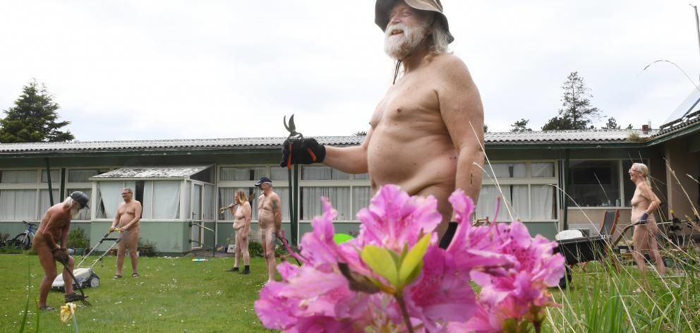 Paul Campion, foreground, marks Nude Gardening Day with a working bee, assisted by (from left)...