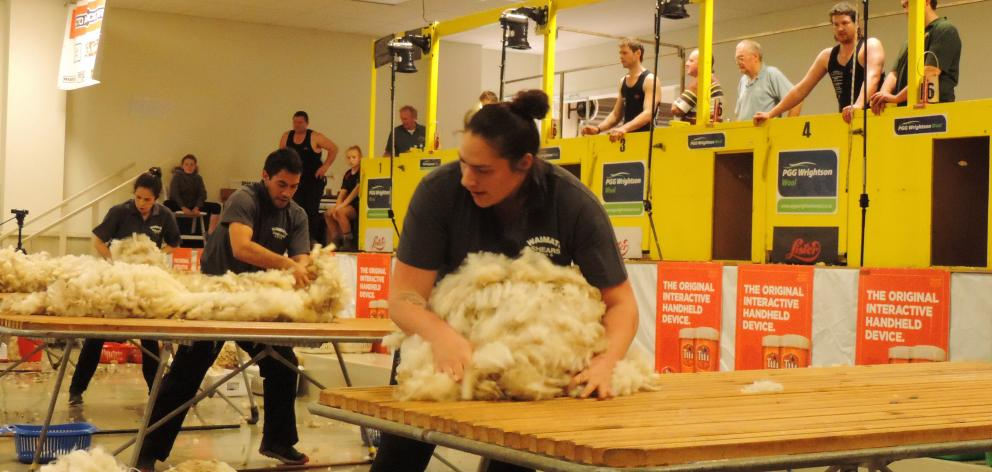 Reigning national woolhandling champion Joel Henare (at centre table) from Gisborne/Motueka made...
