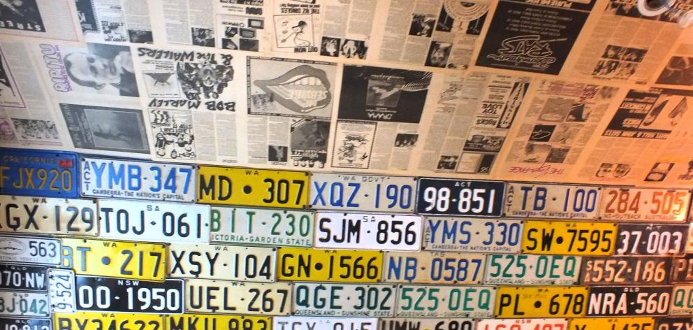 Most of these old licence plates were found in the garage.