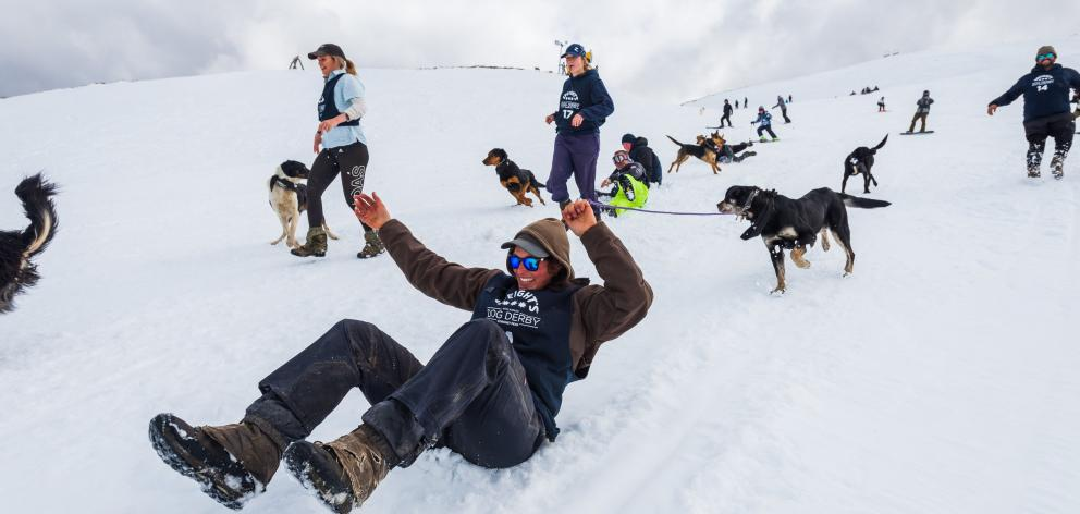 ''Country'' race runner-up Kelly Smith slides down the slope with her dog Missy at the Speight's...