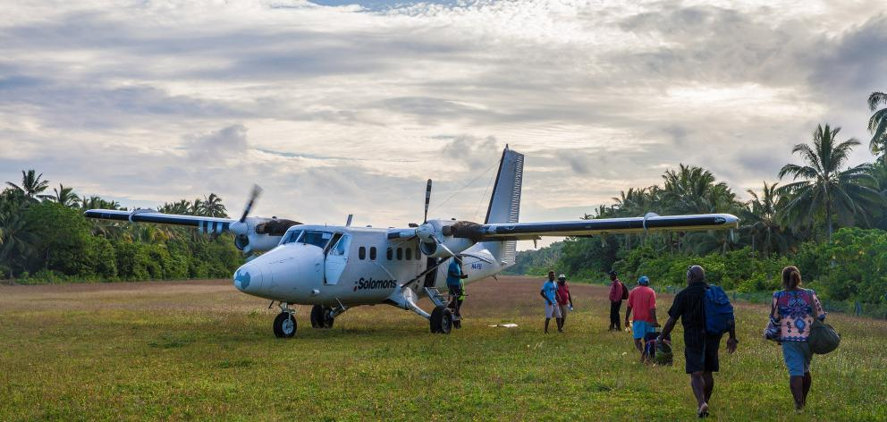 Sixteen-passenger Twin Otters, work horse of Solomon Island Air interisland flights, keeps the...