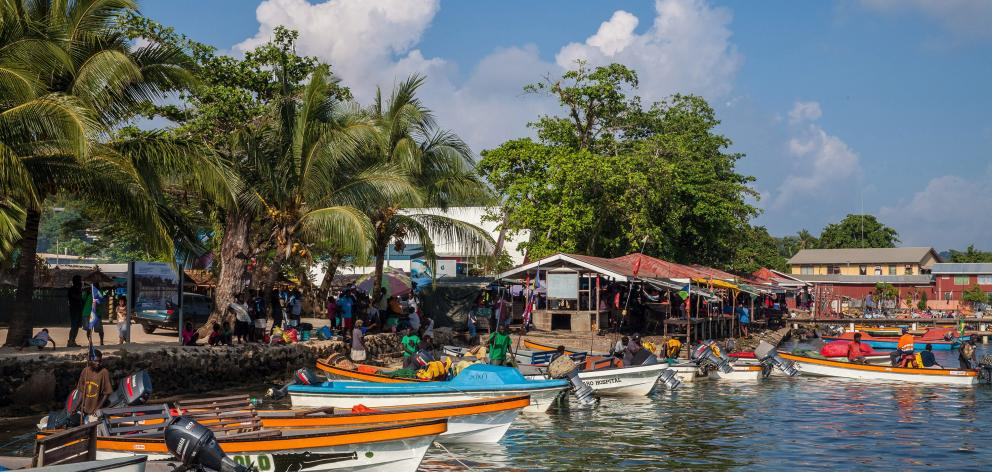 Market day at Gizo, capital of the Western Province, and a ferry stop, is a major event, attended...