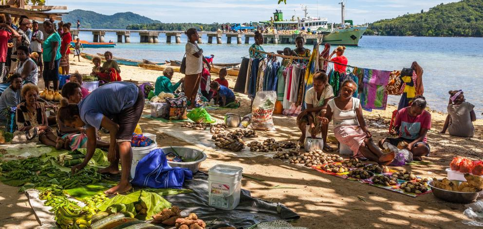 Market day on Marapa Island brings regional families together to buy, sell and visit.