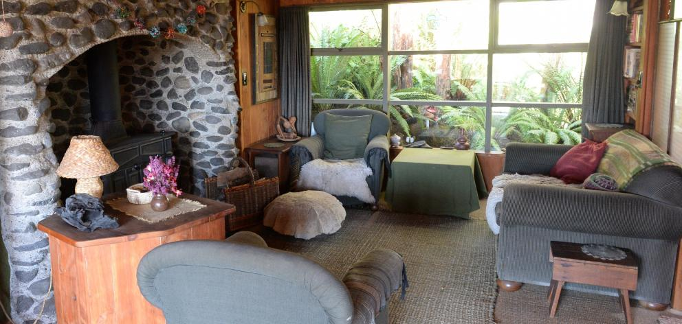 The rustic fireplace in the living area was built by Ms Diettrich and features stone from the...