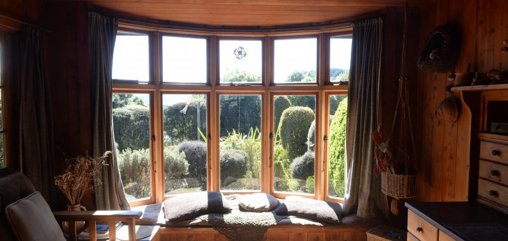 The conservatory-style room at the front of the house has a bay window bought at a demolition...