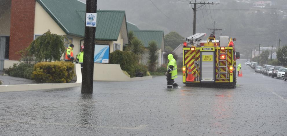 Firefighters check on the flooded Radius Fulton care home in South Dunedin  in February this year...