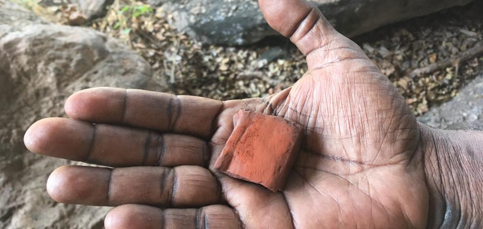 Ayal Aboriginal Cultural Tours owner Victor Cooper shows off some of the ochre rock used in aboriginal rock painting. Photo: Pam Jones