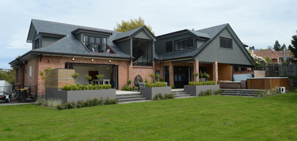 The renovation of this Dunedin home included partial demolition of the exterior to maximise...