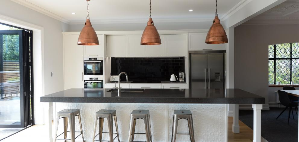 The kitchen was inspired by a picture the owners had cut from a magazine and designed around...