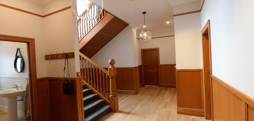 The stairs, panelling and oak flooring in the hall were added by previous owners in the early 2000s.