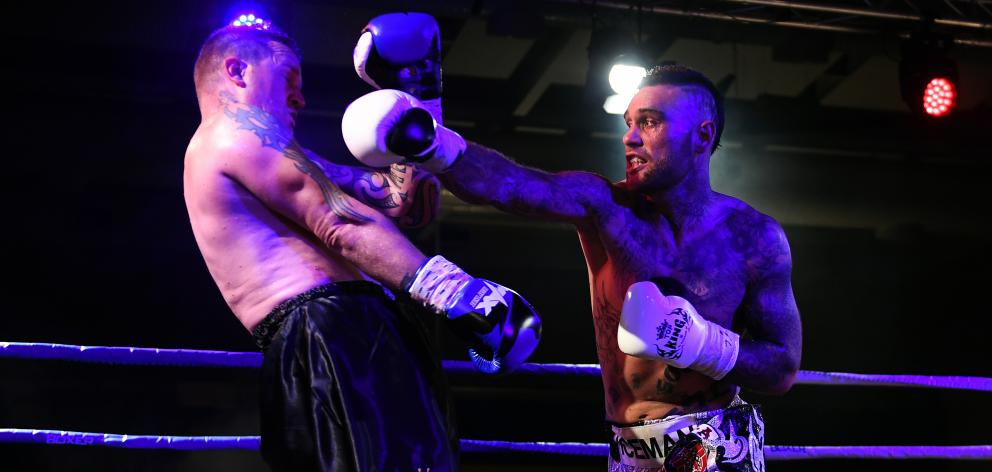 Dunedin boxer Kurt Winklemann in the ring against Waikato's Nigel Elliott at the Edgar Centre on...