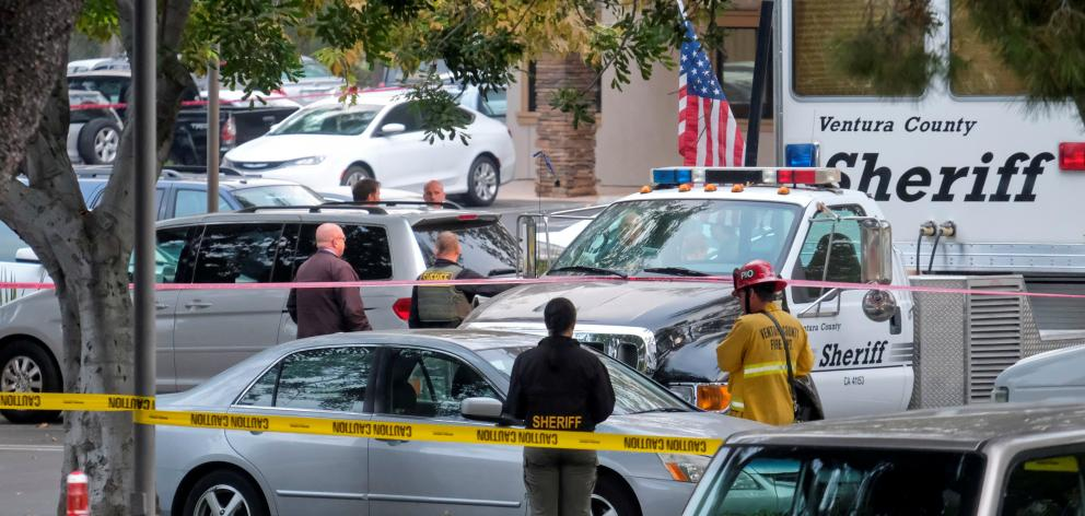 Police guard the site of a mass shooting at a bar in Thousand Oaks. Photo: Reuters