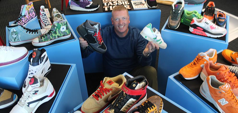 Collector Kevin Downie surrounded by some of his favourite shoes at Classic Motorcycle Mecca in...