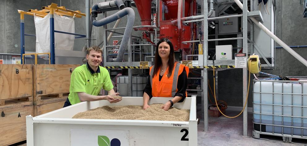 Charlotte Connoley and seed treatment technician Rick van Diepen. Photo: Supplied