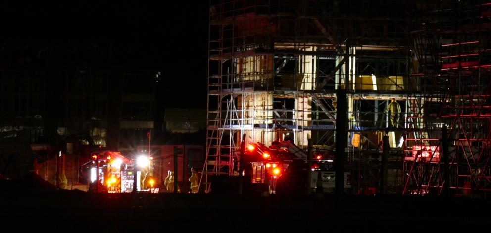Firefighters respond to a fire at a construction site on Hawthorne Drive, in Frankton, last night. Photo: Josh Walton