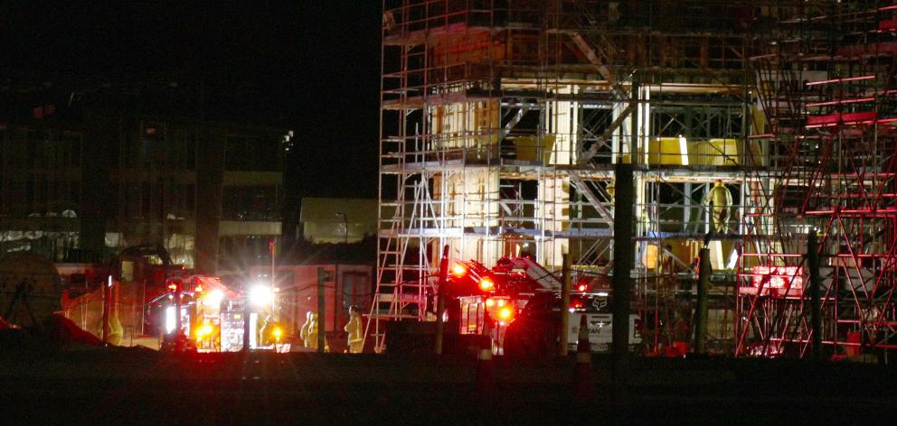 Firefighters and police attend a fire at a construction site in Frankton's Hawthorne Dr on...