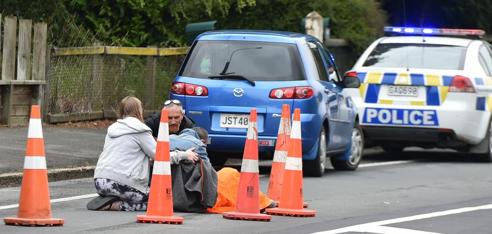 A road rage victim is treated in Wakari. Photo: Gregor Richardson (not Tim Miller please amend)