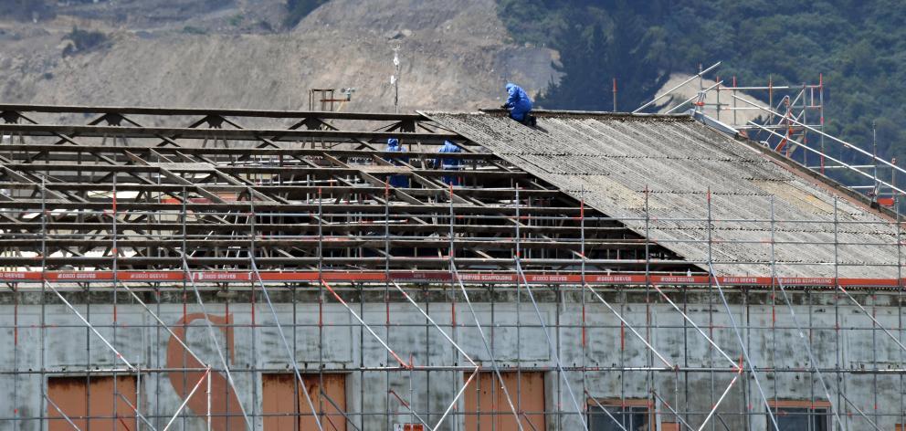 Contractors remove the roof of Port Otago sheds in Fryatt St. Photo: Stephen Jaquiery