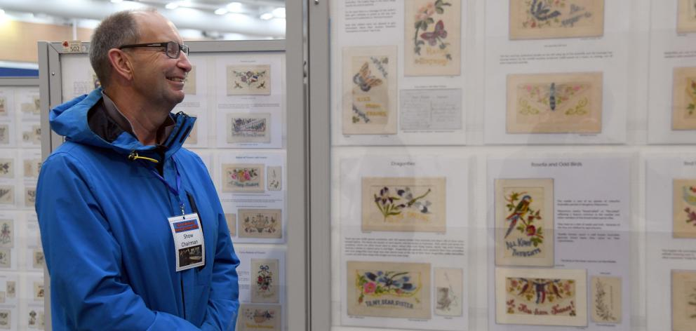 Armistice Stamp Show chairman Mark Gellet  looks at postcards sent back from Belgium and France....