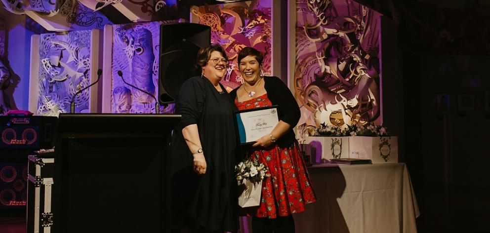 Associa­tion of Administrative Profes­sionals Dunedin branch presi­dent Tracey Fleet (right) receives membership growth and contribution awards from national president Ali McKessar at the recent national confer­ence in Wellington. Photo: Supplied
