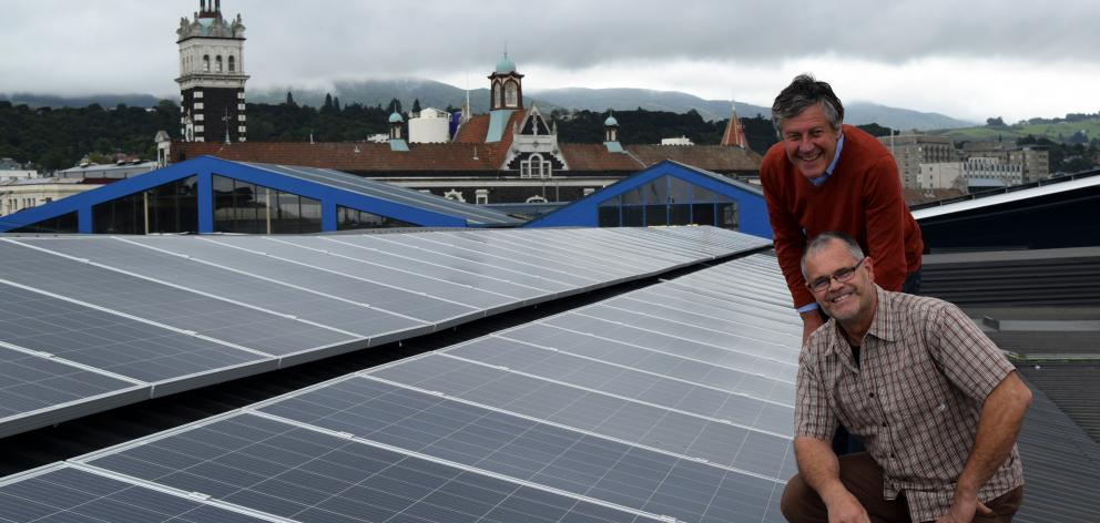 Southern Clams managing director Roger Belton (standing) and operations manager David Redshaw inspect new solar panels installed on the roof of the business in central Dunedin on Monday. Photo: Shawn McAvinue