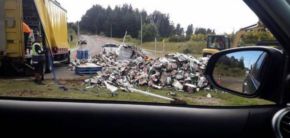 A section of the roundabout was temporarily blocked as a digger was helping the truck driver clean up the mess by the time the witness drove past around 10am. Photo: Supplied via NZ Herald