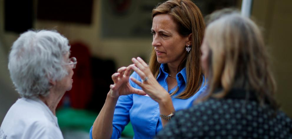 US Democratic congressional candidate Sherrill speaks with people as she campaigns during the New Jersey State Fair. Photo: Reuters