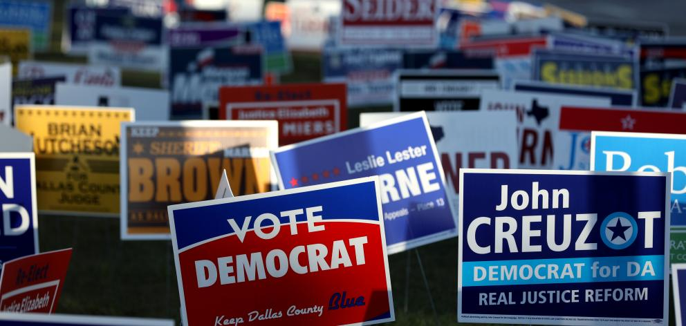 Campaign signs are seen outside a polling station on the last day of early voting in Dallas. Photo: Reuters