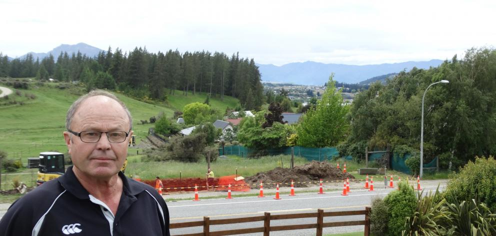 Mt Aspiring Rd resident Barry Bruce is unhappy about the construction of an 11m cellphone tower...