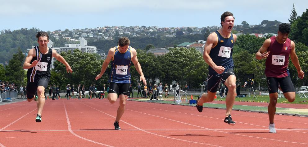 Auckland Grammar School's Dominic Overend (second from right) comes from behind to win the senior...