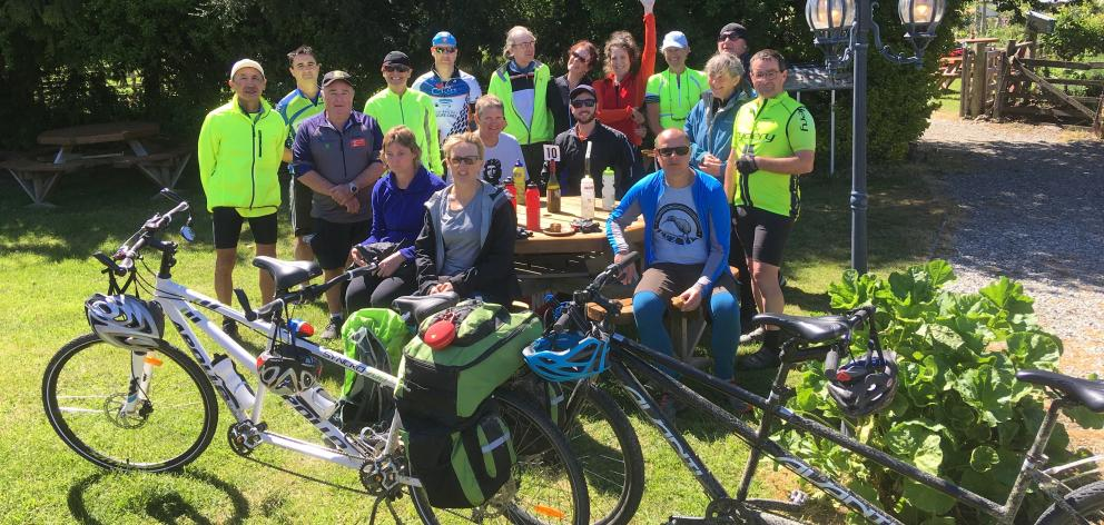 Participants in the Blind Foundation's national tandem bike event take a break after reaching Chatto Creek during their Otago Central Rail Trail ride. Photo: Alexia Johnston