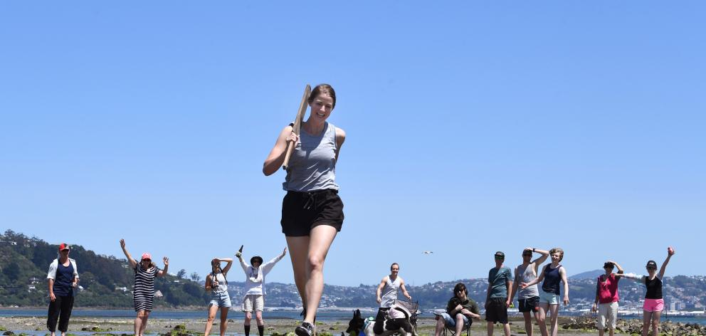 Imogen Stockwell celebrates her Christmas Day birthday with a cricket game on an exposed sandbank in Otago Harbour. Photo: Stephen Jaquiery