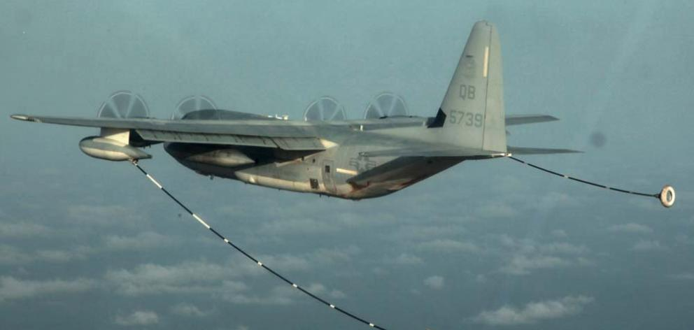 A KC-130 Hercules conducting air refuelling training over the Pacific Ocean. Photo: US Marine Corps photo by Cpl. John Robbart III via Reuters