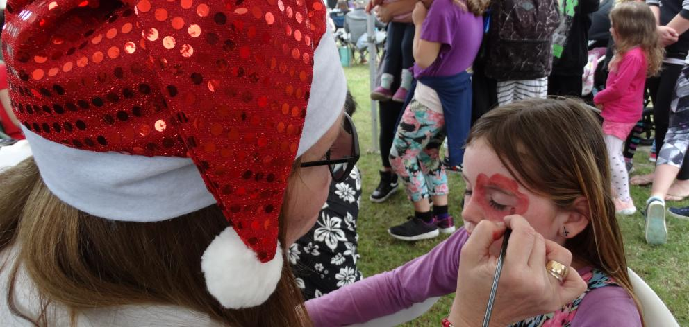 Miley Goodman (9, above) gets her face painted by Sylviane Gallant-Welch.