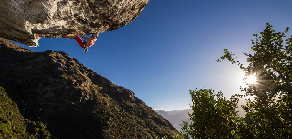 Michal Karnik climbs one of  Queenstown's hardest routes at Wye Creek on Eweniverse. Photo: Guillaume Charton