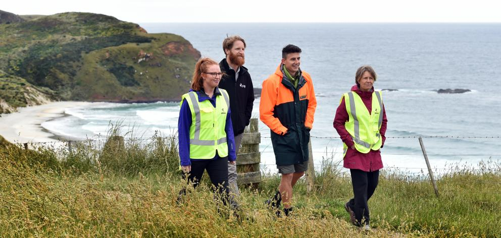 Phoebe Morrison (left), Dunedin City Council parks and recreation planner Stephen Hogg (second from left), Department of Conservation ranger Richard Seed and Lorena Smith start ranger training at Sandfly Bay yesterday. Photo: Peter McIntosh