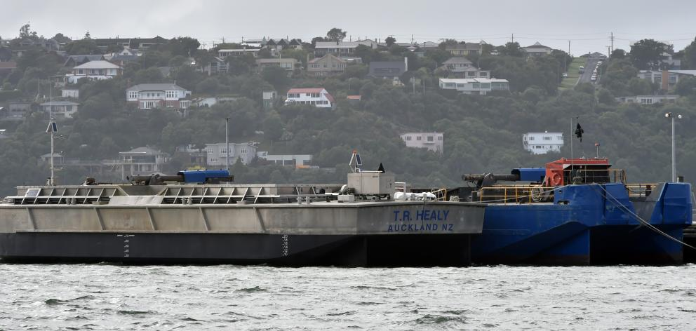 Port Otago's new $1.5million barge TR Healy (left) alongside the $1.4million barge Hapuka in...