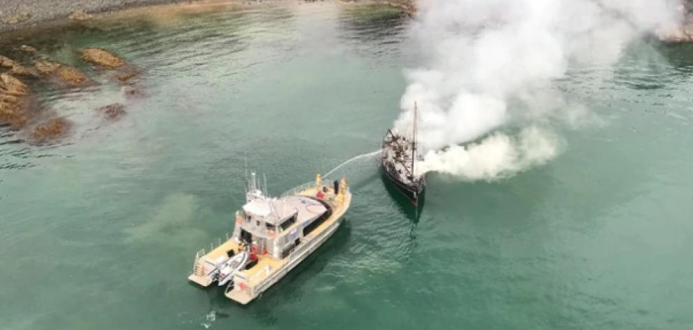 A boat caught fire near Waiheke Island. Photo: Auckland Rescue Helicopter Trust