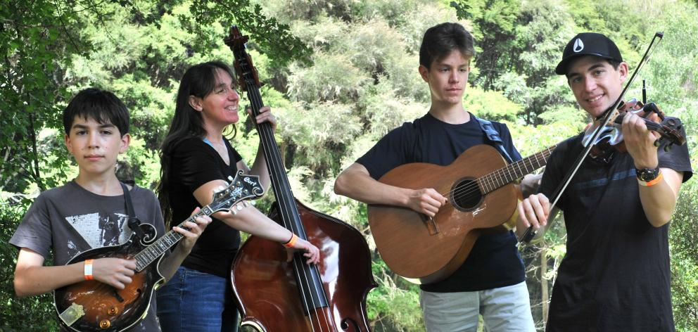 Getting ready to delight the crowds at the Whare Flat Folk Festival are Ngaruawahia family bluegrass band RhodeWorks, featuring (from left) Nate Frangos-Rhodes (12, mandolin), Tracy Frangos (double-bass), Laurence Frangos-Rhodes (17, guitar) and Sam Frang