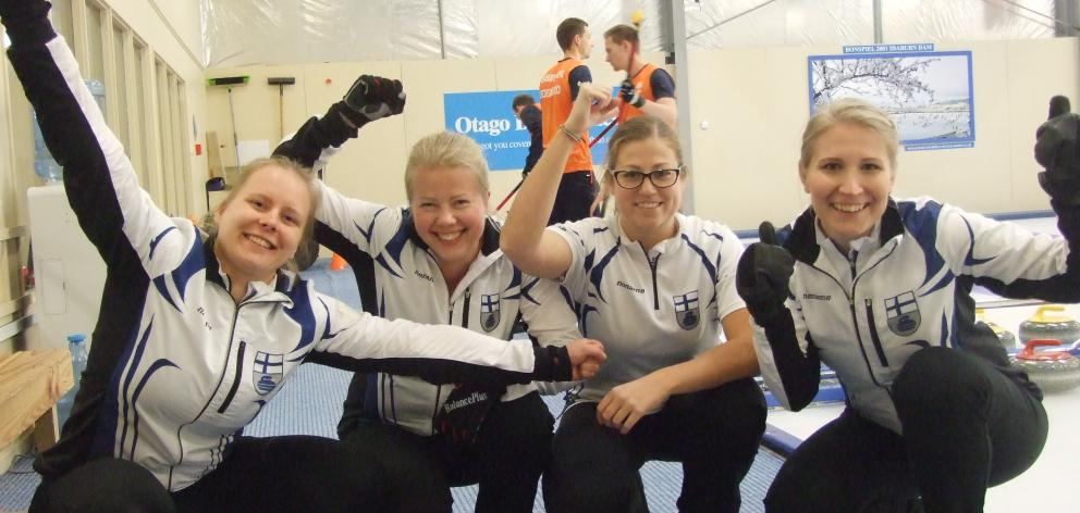 The Finnish women's curling team of (from left) Lotta Immonen, Maija Salmiovirta, Eszter Juhasz and Oona Kauste, following their 8-1 win over Hungary yesterday. Photo: Adam Burns