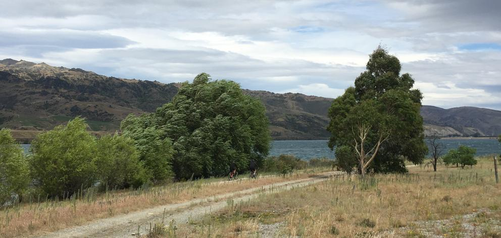 Clouds sit over Lake Dunstan near the Lowburn Cutting. The site is along a proposed cycleway from Cromwell to Wanaka, and where fencing is proposed to block vehicle access to the lake. Photo: Adam Burns