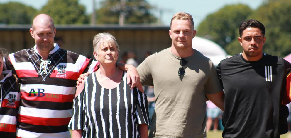 Lining up for the national anthem are (from left) Blair Vining,  his mother Pauline and All...
