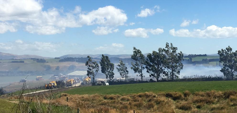 Smoke blankets the scene after a fire broke out at a Clutha farm today. Photo: Richard Davison