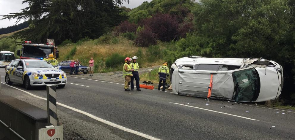 A people mover ended up on its side after a crash near Waitati this afternoon. Photo: Gregor Richardson