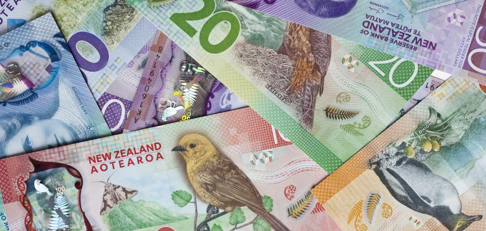 Figures show the median annual income for a New Zealand man working full-time is $56,700 and for...