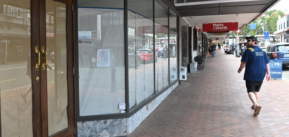 The Madam Woo restaurant in Dunedin, with its windows papered over and its closing notice. The southern hospitality sector is struggling to find enough staff. Photo: Linda Robertson