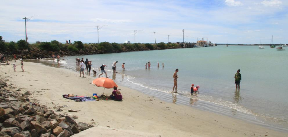 As temperatures approached 30degC in Oamaru about noon yesterday, Friendly Bay Beach at Oamaru Harbour was an oasis for several families. Photo: Hamish MacLean