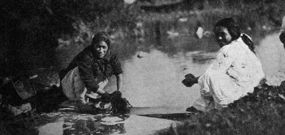Maori women doing their washing at Ohinemutu, Rotorua. — Otago Witness, 8.1.1919.